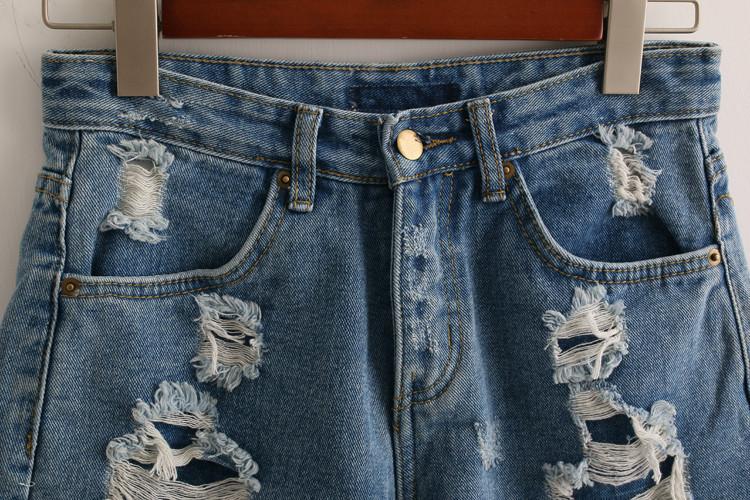 宽松显瘦毛边破洞牛仔短裤